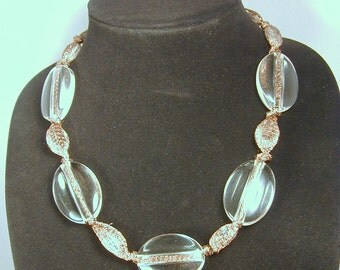 Chunky, crystal clear lucite ovals on copper mesh ribbon