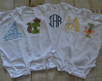 Monogrammed baby bodysuit.