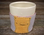 handmade stoneware cup with hand-stitched wool felt cozy: cat