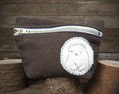 hand-embroidered hemp stand up pouch: bear in crown by kata golda