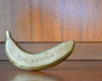 vintage brass top banana paperweight