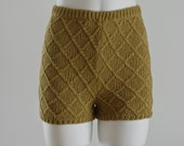 High waisted hand knitted shorts in rich olive green