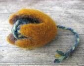 Felted flower brooch,braid decoration.