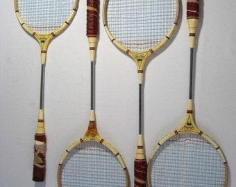 set of four vintage badminton racquets