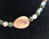 16 inch beaded necklace with moonstone focal bead, serpentine, and crystal Quartz