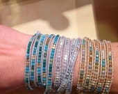 """5 wrap bracelet! Handmade with brass, crystals and semi precious stones and """"vegan leather"""". Adjustable sizing."""