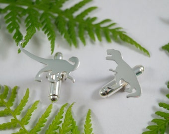Silver Dinosaur cufflinks: A pair of T Rex and Raptor shaped sterling silver cufflinks.