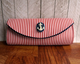 Nautical clutch purse with blue anchor cameo. Red clutch, red and white striped clutch.