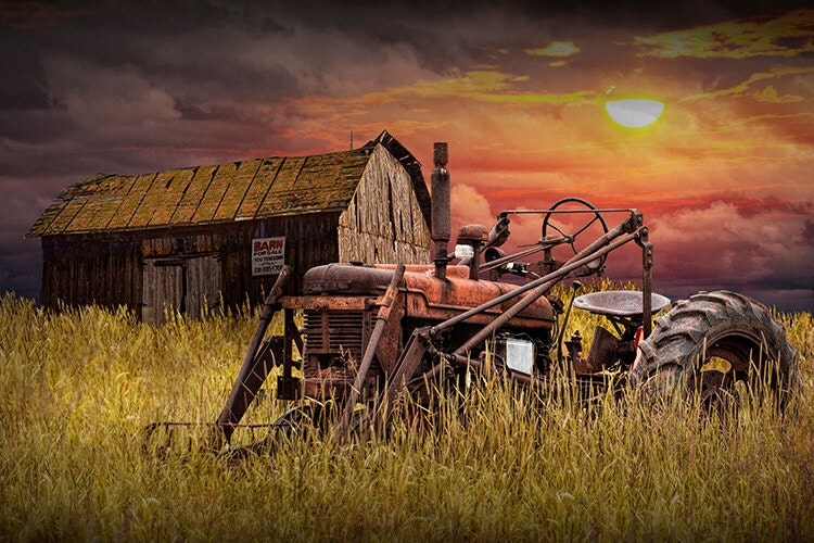 Barn For Sale With Rusty Red Farmall Farm Tractor In A Grassy