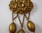 Art Deco Goldtone  brooch with festoon chain and charms