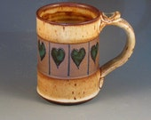 RESERVED FOR LORI.....Hand Made Mug With Hearts Carved In, Soft Brown Glaze With Specks, Textured Handle, Ready To Ship