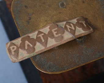 Antique metal finding, plate, embellishment. Patent