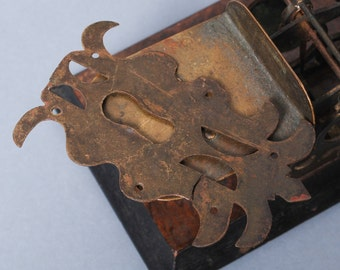 Antique brass key hole escutcheon. Original dark patina.