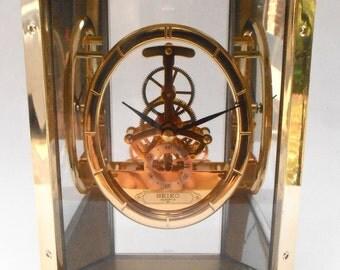 Vintage Seiko Table Clock Mirror See Through Glass Case Acrylic Transparent Oval Skeleton Mantle Gears Ref QAW110G Japan Quartz Gold Tone