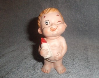 vintage porcelain baby figurine with bottle
