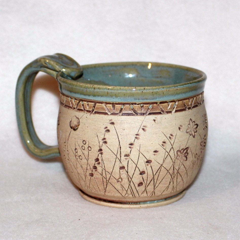 Ceramic pottery mug carved flowers
