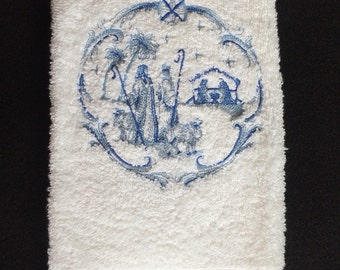 Christmas Manger and Wise Men Embroidered Bath Hand Towel. The scene is embroidered in beautiful blues