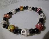 White Turq Skulls and Unique Clay Pieces/ Black Wood-Unisex-Beaded Stretch Bracelet  (384)