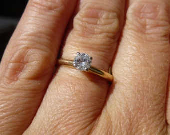 Does not get any more classic then the single diamond on a band  27 point Diamond  Engagment ring
