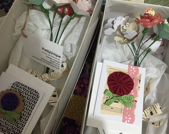 Paper flower bunch with small gift card.