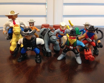 Vintage Action figures cowboys horses 11 peice sheriff robber