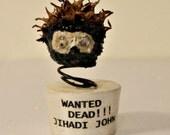 ISIS Terrorist (Jihadi John) WANTED DEAD!!! Made From The Sweet Gumball Pod.