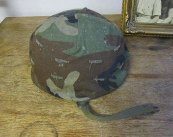 M1 Helmet with camo and liner.