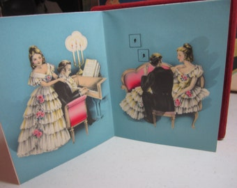Gorgeous 1930's-40's art deco unused Gibson christmas card to a sweetheart with colorful graphics of a well dressed victorian couple in love