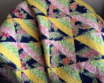 "Navy, Pink, Green, Yellow, Orange and The Tropics Blend Perfectly In This 49"" X 56.75"" Half Square Triangle Quilt"