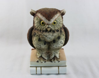 Vintage Owl Sitting on Two Books by Andrea