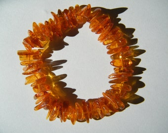 Strechy Baltic Amber Bracelet - -   Jewelry - - Shiny Honey Color Oblong Natural Genuine Baltic Amber.