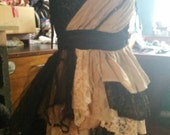 Layered asymmetrical fairy like belarinna dress in black, taupe and gold. Made with silks lace and tulle