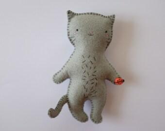 Grey cat kitten cute handmade felt plush doll holding a ladybird