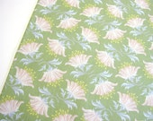 Quilting cotton fabric in green with lily flower print, Painted Lily Green from Tilda fabrics.