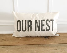 Distressed OUR NEST Pillow Cover