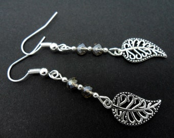 A pair of pretty tibetan silver leaf & champagne crystal dangly earrings.