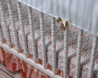 Swatches for Coral, Metallic Gold and Mint/Aqua Girl Crib bedding.