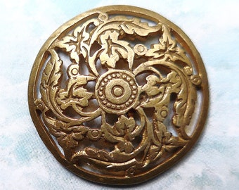 Pierced metal button, antique with a design of swirling leaves. brass. 19th. century.