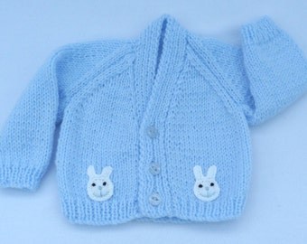 Baby sweater. Premature baby cardigan hand knitted in pale blue