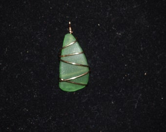 green glass wrapped in copper wire