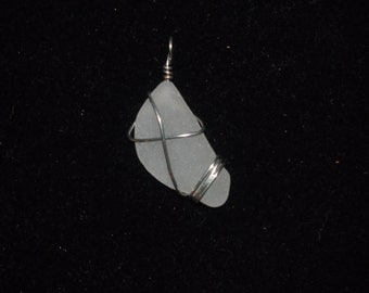 white glass with silver wire