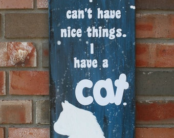 wooden 'cat' sign
