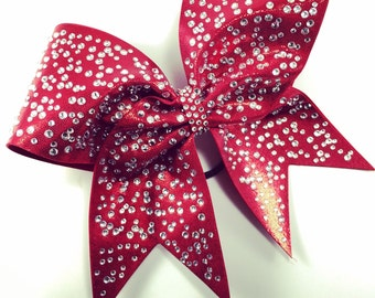 Mystique fabric cheer bow with diggerent sizes crystals.