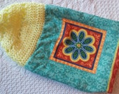 Flower dishtowel with a yellow crocheted topper with a teal blue button!