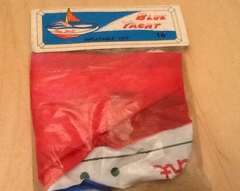 1960's dime store inflatable blue yacht toy.