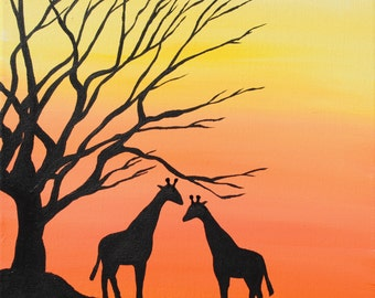Giraffes Grazing in the Sunset