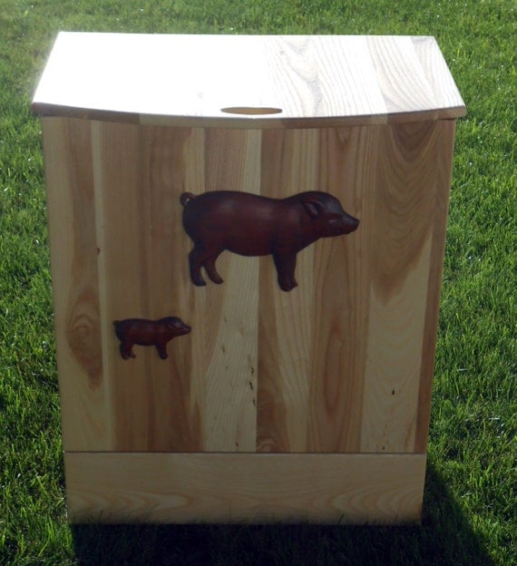 Solid Hickory Trash Bin with storage drawer. Complete with 3D carvings of a few of your favorite animals.