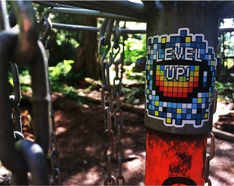 Level up - by Decaffeinated Designs (3x3) Waterproof and durable clear vinyl decal sticker