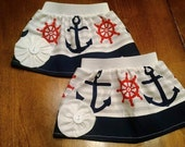 Nautical skirt Newborn/infant/Baby/Kid Sizes. Nautical/anchor skirt with a flower and elastic waist. Cute baby/infant clothing/skirt.