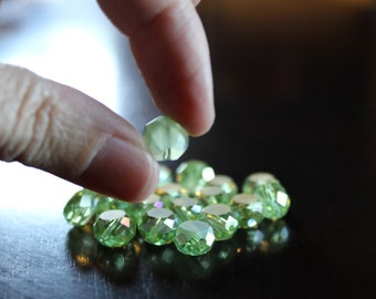 20 glass electroplated 10 mm beads, flat round, faceted around edges, one side frosted, light green